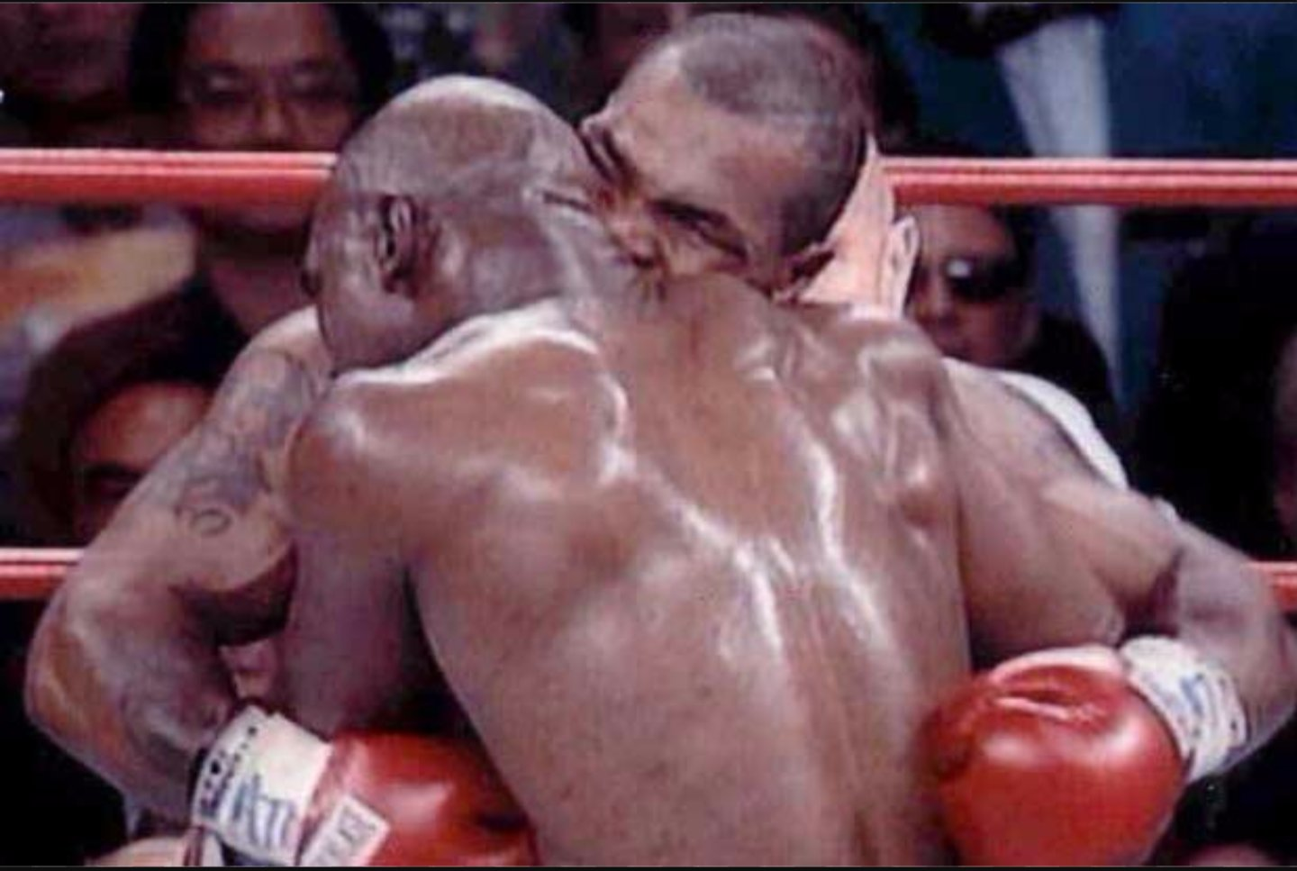 Image result for boxer mike tyson was disqualified for biting evander holyfield's ear.