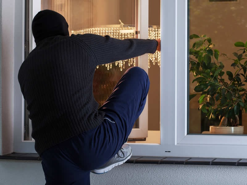 Burglar Breaking Into Residential Home