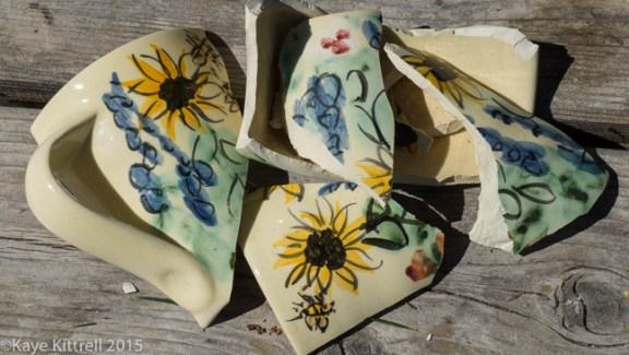 Lament for a Garden Hat and Teacup - broken cup