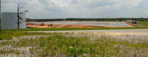 May 2012. The Wrangler distribution center site, ready for new construction. The pine tree on the left retains a large piece of sheet metal from the storm.