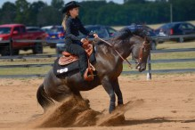 Fall brings out athletic competition: western style riding at a college equestrian meet.