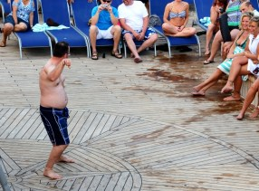 A dance contest among men on the ship's deck. What you do on a cruise stays on a cruise—that's the motto.