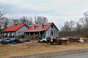 Many homes, especially away from town, are surrounded with junk and used cars.