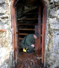 Scott Teodorski unlocking the entrance to Gap Cave.