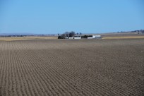 Neatly plowed rows on a farm in Scott's Bluff, Nebraska