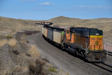 Coal train running through the range country of western Nebraska. I counted 131 coal cars in this train, making it an estimated 1.5 miles long.