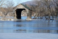 The same covered bridge during the flood, Friday, Feb. 26