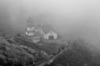 The lighthouse at Point Reyes National Seashore, in black and white.