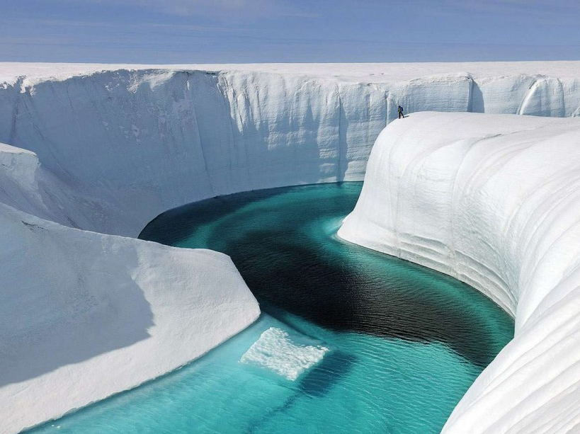 """This 2009 photo released by Extreme Ice Survey shows Birthday Canyon in Greenland furing the filming of """"Chasing Ice."""" The film, about climate change, follows National Geographic photographer James Balog across the Arctic as he deploys revolutionary time-lapse cameras designed to capture a multi-year record of the world's changing glaciers. (AP Photo/Extreme Ice Survey, James Balog)/NYET277/227950515096/AP PROVIDES ACCESS TO THIS PUBLICLY DISTRIBUTED HANDOUT PHOTO PROVIDED BY EXTREME ICE SURVEY FOR EDITORIAL PURPOSES ONLY./1211022112"""