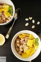 Bowls of peanut salad with mango.