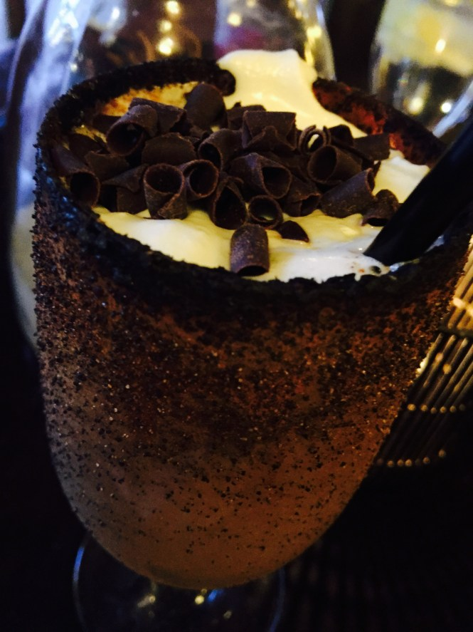 Flaming Hot Coffee a mixture of fire, a dash of sugar, tequila, liqueur and freshly made whip cream sprinkled with chocolate shavings