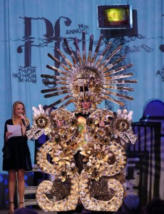 """Mojardin won the grand prize with his creation """"Aztec Princess"""" modeled by Itzel Gonzalez.The design was as made entirely, 100%, paper and we tell the story of Quetzalcuatl, the feathered serpent. Photo by Jonathan Garcia"""
