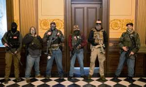 man standing with guns in capitol
