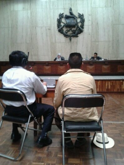 Witness Domingo Santiago Cedillo sits before the court accompanied by an interpreter but he chose to give his testimony in Spanish, interrupted only by tears.