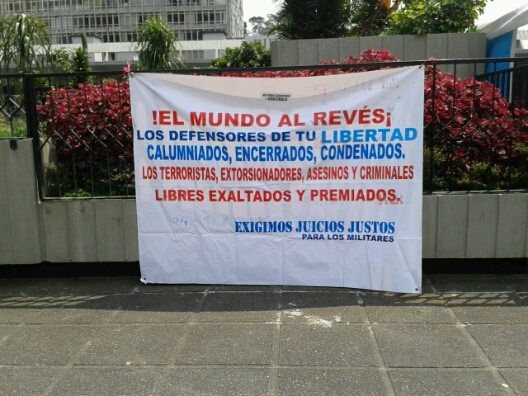 """Pro-military sign outside the courtroom. """"The world is upside-down! ...We demand fair trials for military officials."""""""