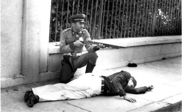 Officer Luis Anés Mariani takes cover behind a dead Cadet.