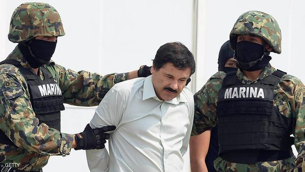 "Mexican drug trafficker Joaquin Guzman Loera aka ""el Chapo Guzman"" (C), is escorted by marines as he is presented to the press on February 22, 2014 in Mexico City. (Alfredo Estrella /AFP/Getty Images)"