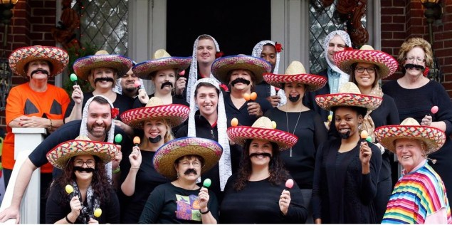 University of Louisville Pres. James Ramsey (far right) poses for a Halloween photo with staff