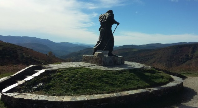 Statue of a windswept pilgrim on Alto de Roque, Galicia