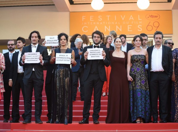The Cannes red carpet was the scene of an unusual political protest as the cast and crew of the Brazilian film 'Aquarius' held banners denouncing the suspension of Dilma Rousseff as a 'coup d'etat.""