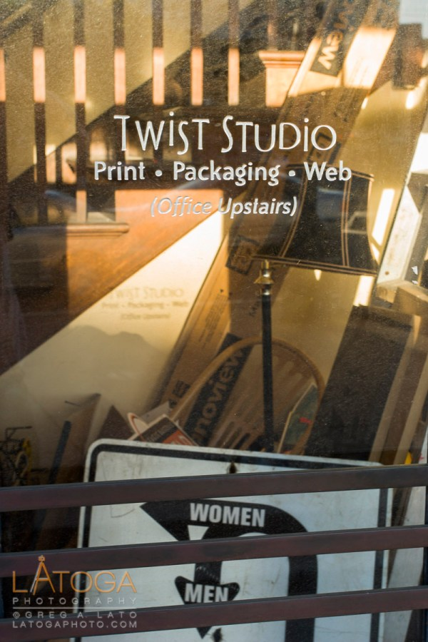 Office Window of Twist Studios in San Francisco, California showing clutter and Signs.