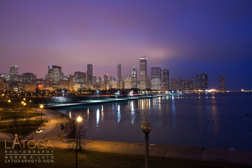 Night time winter skyline of Downtown Chicago as seen from the Shedd Aquarium.