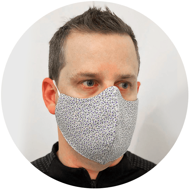 Wholesale Face Masks: Designer reusable face mask with floral pattern worn by a man