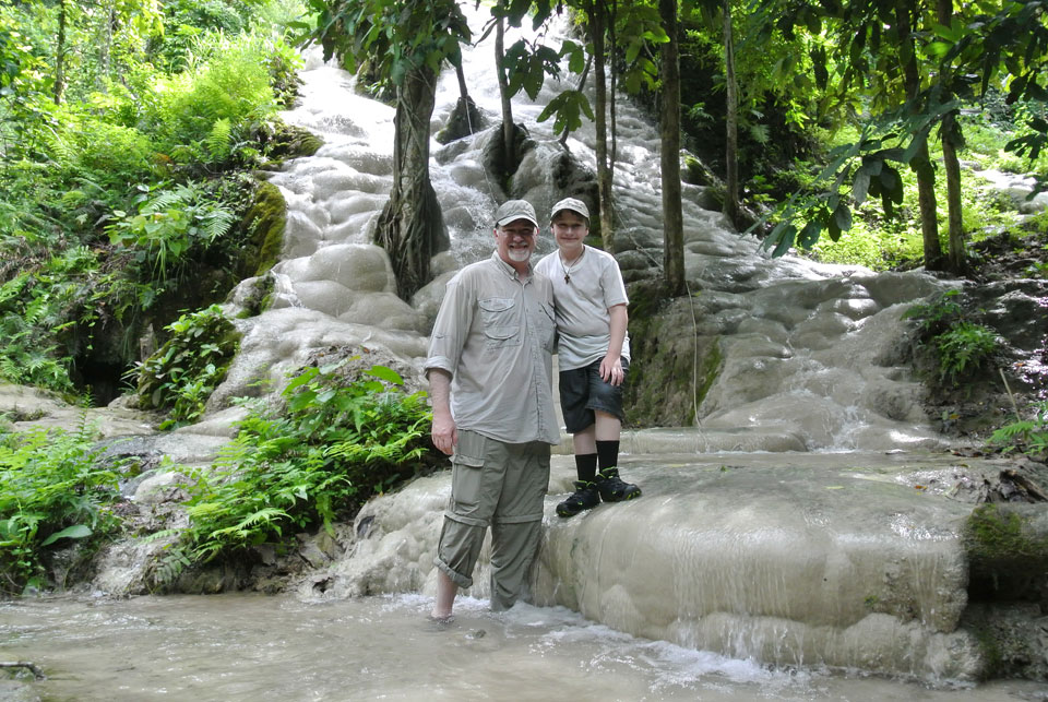 John & Josiah share a father-son adventure climbing hundreds of feet of waterfall in Northern Thailand.