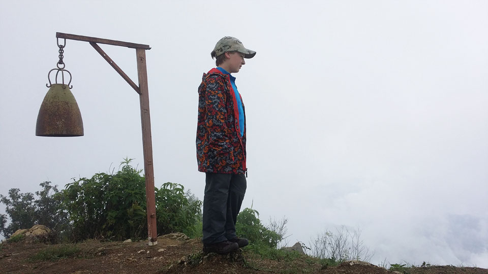 Josiah standing on top of the tallest rock we could find on the summit, looking out toward Myanmar.