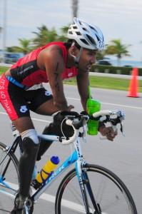 rajeshdurbalonbike 199x300 Triple amputee Ironman: journey and humility inspires