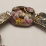 Focal bead of floral bracelet