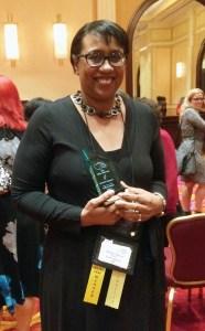 K.M. Jackson with her Golden Leaf Award