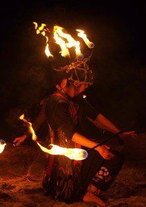 fire dancer kneeling