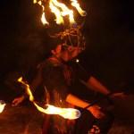 fire dancer kneeling