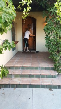 My mama, opening our door to our beautiful bungalow.