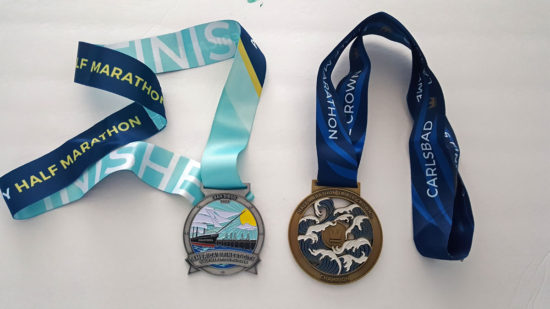 Finisher medals: Left- AFC Half Marathon medal. Right-Triple Crown Medal