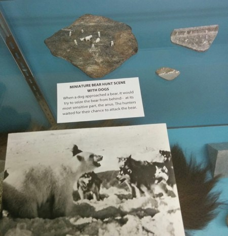 hunting polar bears with dogs - tiny Inuit carvings and photo