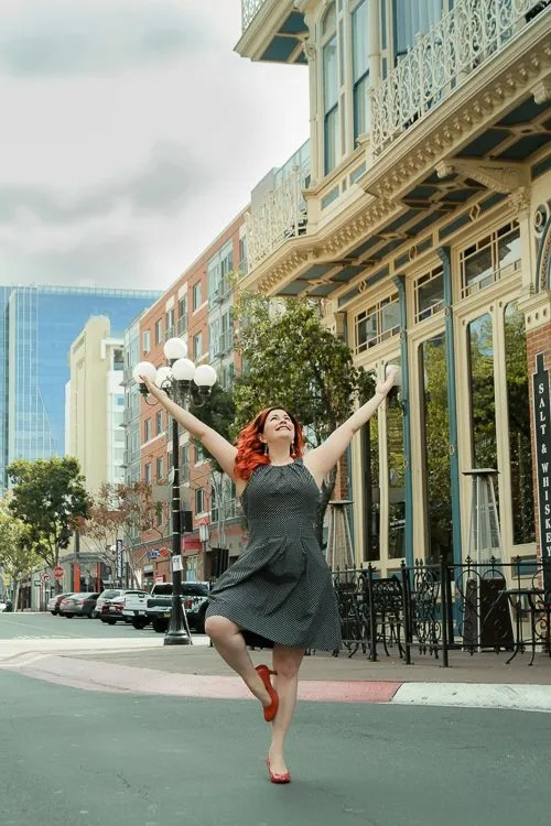 Doing yoga in the middle of the street, Christine Gritmon holds tree pose in San Diego Gaslamp District for her headshots session with Laura Pearman