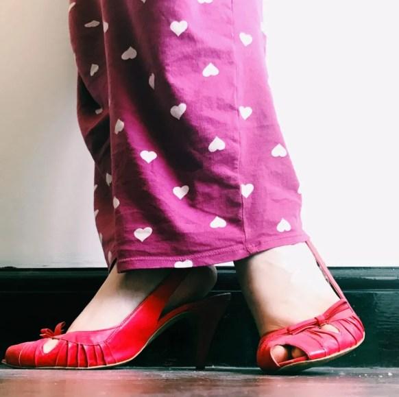 red high heels with purple pj bottoms selfie