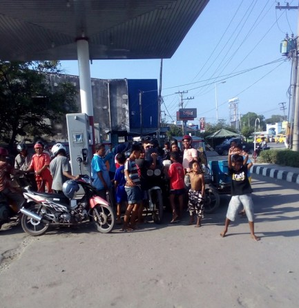 Our friend and fellow biker, Michael, trying to fill up in Belawan, Sumatra