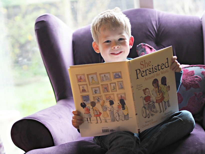 CHILDREN'S BOOK REVIEW She Persisted Around the World - Logan with the book