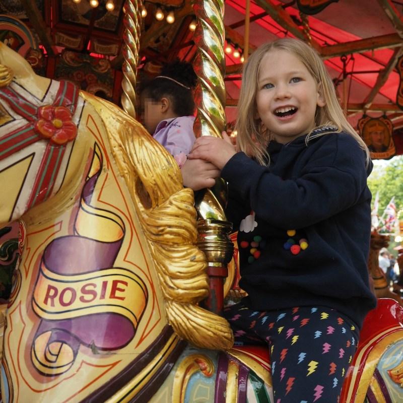 Aria sitting on carousel horse