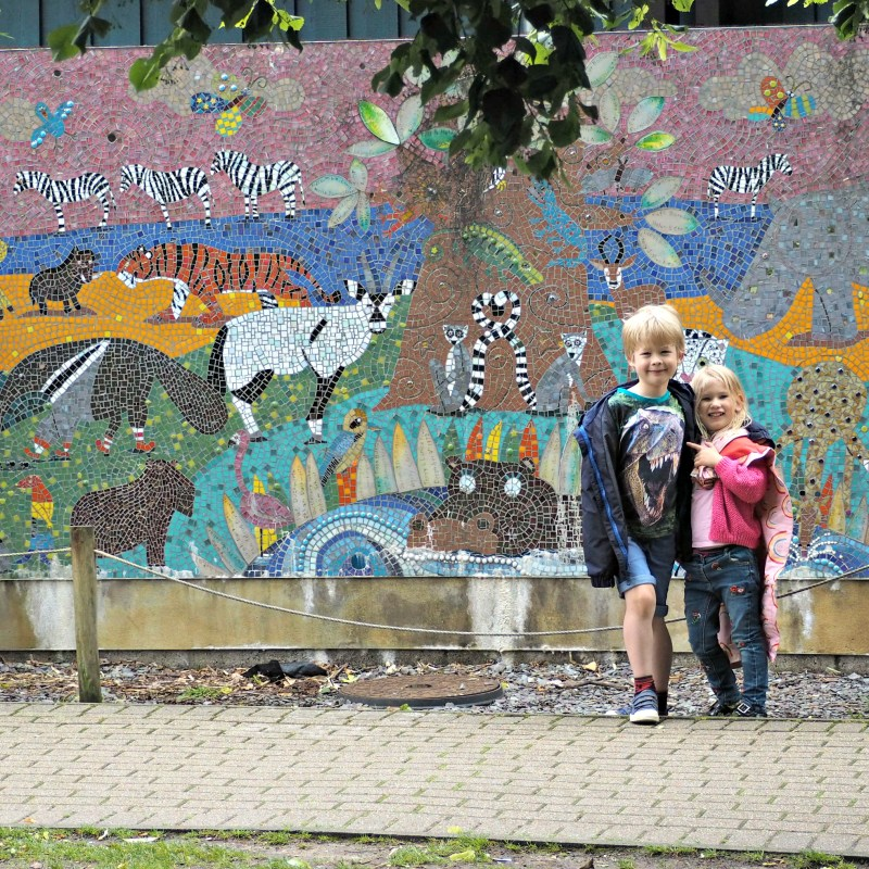 REVIEW: Marwell Zoo #BRICKOSAURUS - Aria and Logan standing in front of a zoo mural