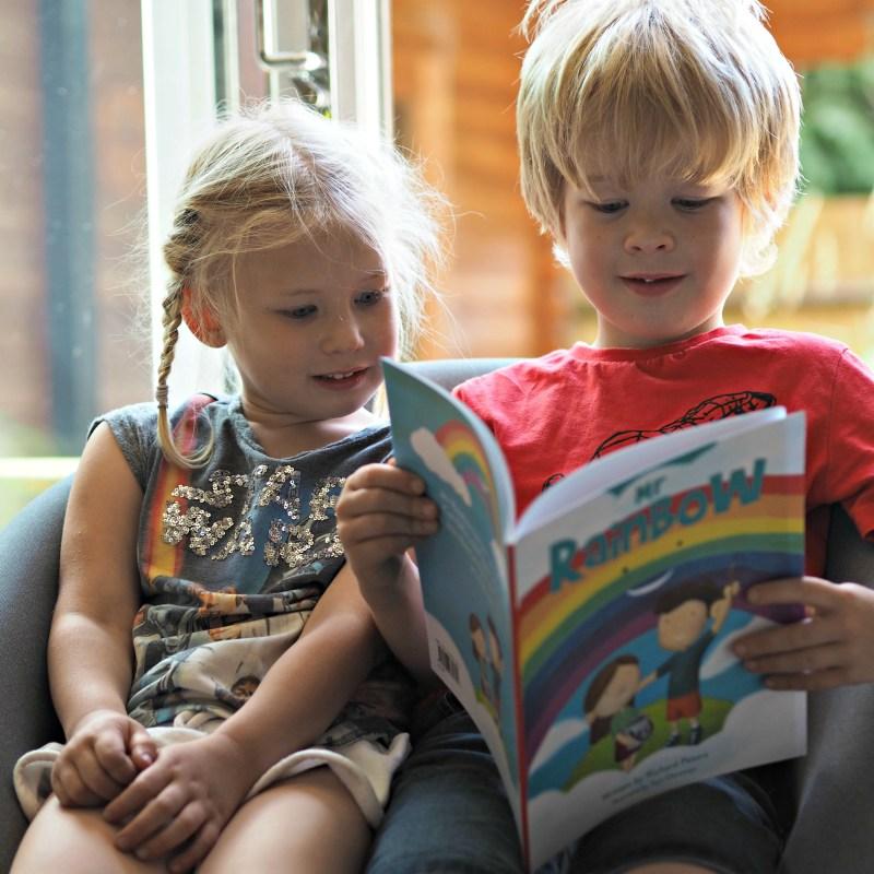 Logan and Aria reading Mr. Rainbow