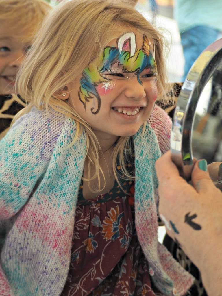 Aria seeing her face paint for the first time
