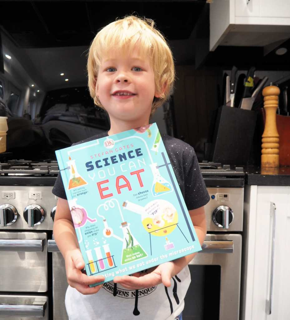 CHILDREN'S BOOK REVIEW: Science You Can Eat - Logan holding the book