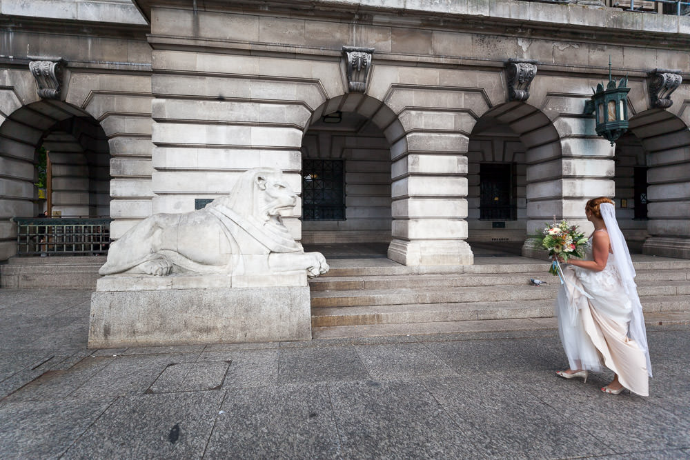bride approaches leftlion outside council house Nottingham Wedding venue