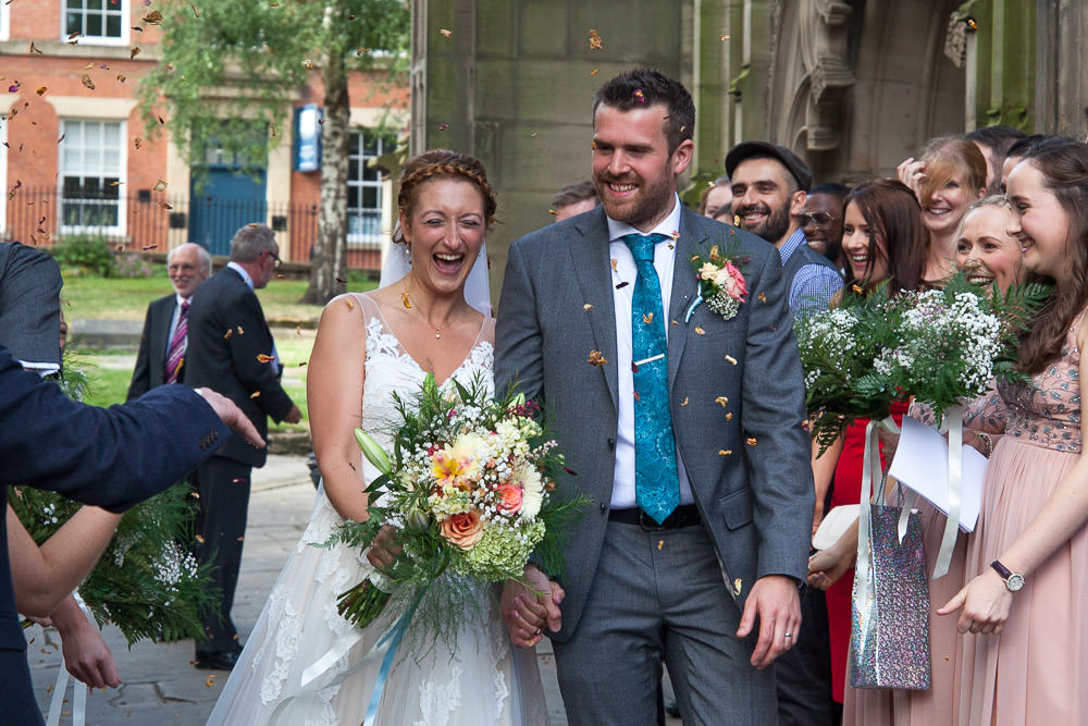 Confetti thrown at just married couple at St Mary's Church Nottingham Wedding Venue