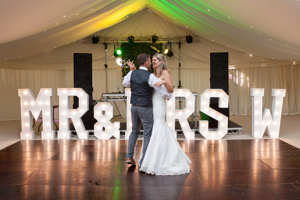 bride and grooms first dance at Tros Yr Afon wedding venue, DIY Beaumaris castle wedding