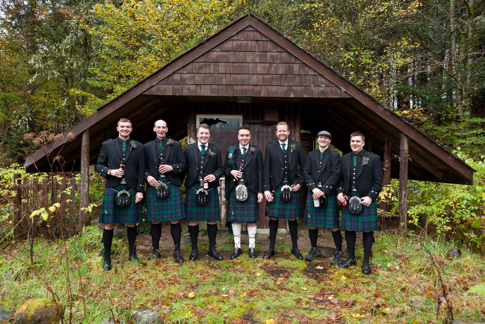 Groomsmen laughing at Balmacara campsite before they do to Isle of Skye Wedding